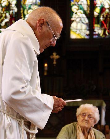 catholism: Goring, Berkshire, UK, 25th October 2009, a priest  vicar doing a christening service