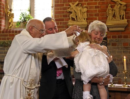 catholism: Goring, Berkshire, UK, 25th October 2009, the christening service of a baby girl with her nanny and uncle