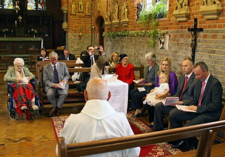 Goring, Berkshire, UK, 25th October 2009, a priest  vicar doing a childs christening service