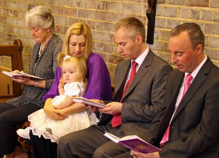 catholism: Goring, Berkshire, UK, 25th October 2009, a family at the christening service of a baby girl
