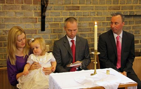 catholism: Goring, Berkshire, UK, 25th October 2009, a family at the christening service of their baby girl