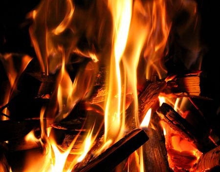 kindling: Flame and kindling wood burning in a camp fire