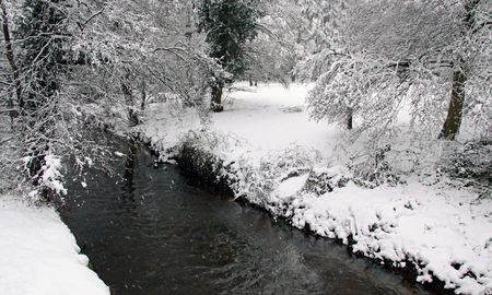 View of a river flowing through forest in winter snow Stock Photo - 6408776