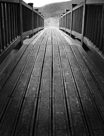 A wooden bridge crossing over into rural countryside Stock Photo - 6529295