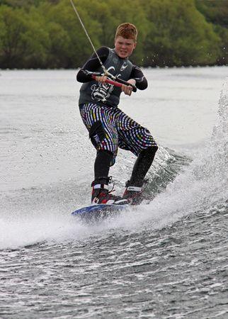 Heron Lake, Wraysbury, UK April 25th 2010 a young boy Wake Boarder  wakeboarding at the British Disabled Water Ski-ing Association BDWSA