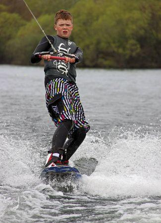 Heron Lake, Wraysbury, UK April 25th 2010: a young boy Wake Boarder  wakeboarding at the British Disabled Water Ski-ing Association BDWSA
