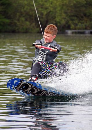 Heron Lake, Wraysbury, UK April 25th 2010: a young boy Wake Boarder / wakeboarding at the British Disabled Water Ski-ing Association BDWSA Stock Photo - 6897813