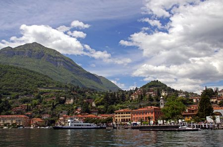 View of town settlement, blue sky, mountains and Lake Como in Italy Stock Photo - 7092858