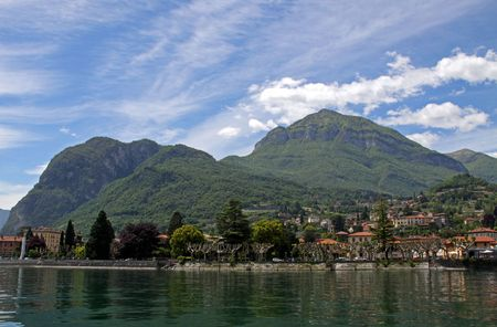 View of town settlement, blue sky, mountains and Lake Como in Italy Stock Photo - 7092852