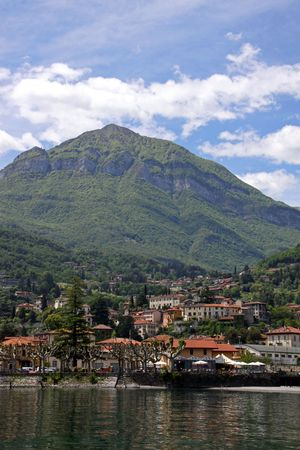 A hillside town and mountains at Lake Como, Italy photo