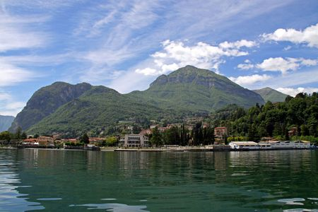 View of town settlement, blue sky, mountains and Lake Como in Italy Stock Photo - 7092854