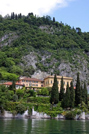View of town settlement, blue sky, mountain and Lake Como in Italy Stock Photo - 7092880