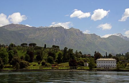 A house on the shore of Lake Como in Italy with Treviso mountains Stock Photo - 7102734