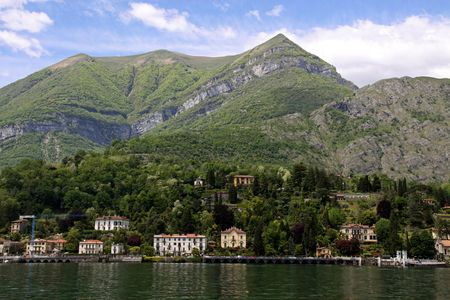 View of town settlement, blue sky, mountains and Lake Como in Italy Stock Photo - 7102799