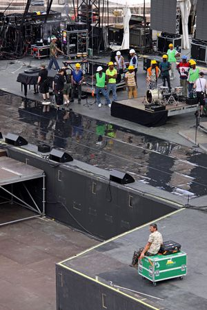 May 22nd, 2010 The Arena colosseum in Verona, Veneto, Italy, Roadies, electricians, engineers and sound test crew setting up for the Michael Buble tour in the ancient Roman Empire structure