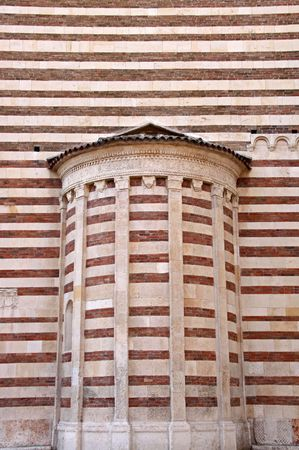 catholism: Archtiectural detail of a wall of The Duomo church bell tower in Verona, Italy