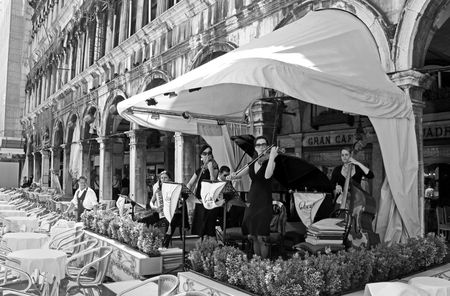 St Marks Square, Venice, Italy, 21510 an orchestra of musicians play live classical music in Piazza San Marco