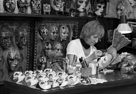 Venice, Italy, 21510 the owner of a papier mache art shop painting a mask