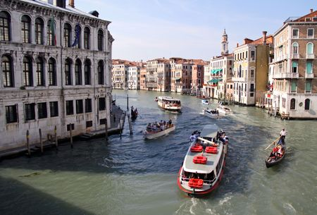 From the Rialto Bridge, Venice, Italy, 21510 tourist river boats and gondola and gondolier