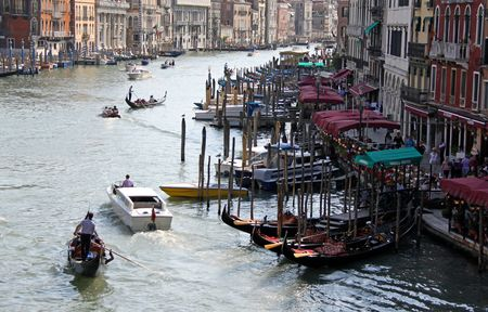 From the Rialto Bridge, Venice, Italy, 21/5/10 tourist river boats and gondolas and gondoliers Stock Photo - 7797913