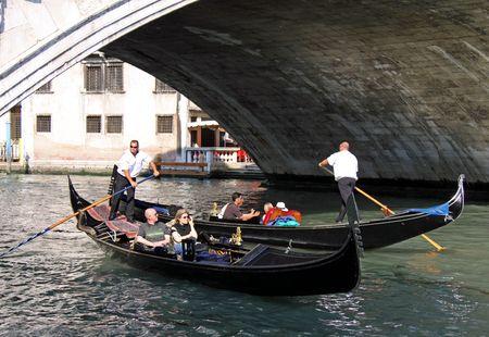gondoliers: Under the Rialto Bridge, Venice, Italy, 21510 tourists in gondolas with gondoliers
