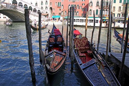 gondoliers: Venice, Italy, 21510 Italian gondoliers and tourists in gondolas next to the Rialto Bridge on the Grand Canal