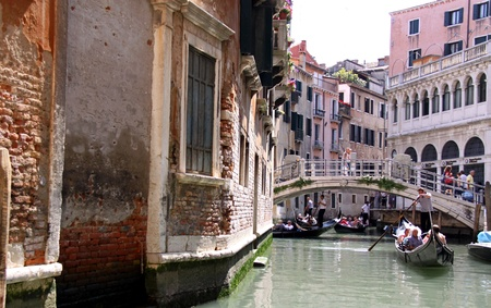 Venice, Italy, 21/5/10 Italian gondoliers and tourist passengers in gondolas on a Venetian canal Stock Photo - 9472223