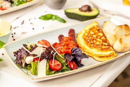 The concept of an Italian breakfast. omelette and salad. background image. Copy space, selective focus