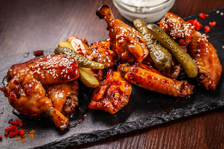 American cuisine, fried chicken wings barbecue in glaze sauce. The concept of American street food.