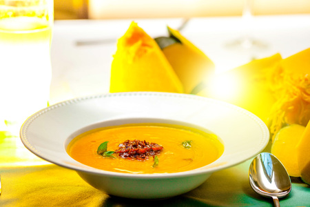 Dinner for Halloween, cream pumpkin soup with carrots and bacon, beautiful serve in the restaurant, cafe. Family holiday or dinner. Copy space