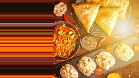 Assorted Uzbek food set, pilaf, samsa, lagman, manta and Korean carrots, Uzbek restaurant concept, Uzbek food feast. Festive, homemade lunch, dinner for the whole family. copy space, top view