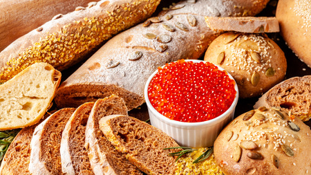 Ukrainian and Russian cuisine. Red caviar with homemade wholegrain bread. Фото со стока