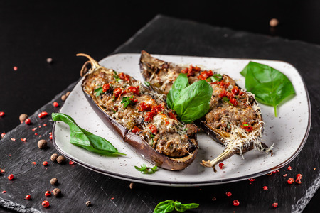Portuguese cuisine. Baked eggplants with mushrooms, meat, vegetables and parmesan cheese. Copy space, selective focus