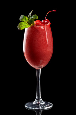 Classic fresh juices from fruits and vegetables on a black background in glass cups, cocktails. Drinks with bottom ejection. Isolate for the menu of restaurants, bars and cafes.