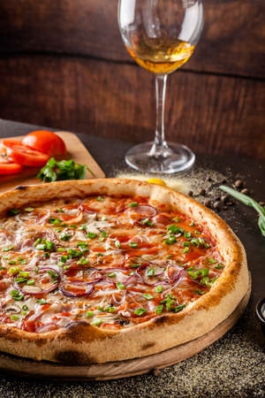 Italian Cuisine. Thin pizza with bacon, red onion, green onion and mushrooms in tomato sauce. Background image. copy space Stok Fotoğraf
