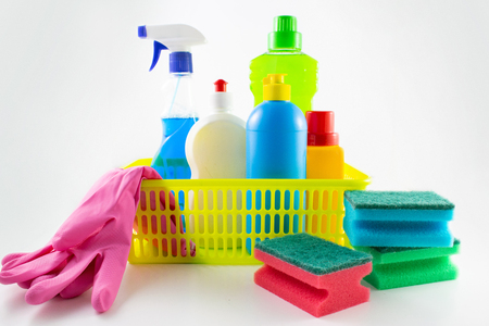 Image close-up detergent. The concept of Service for cleaning apartments and premises, cleanliness. Cleaning dust and dirt in the kitchen, on the floor, Various sanitation items, cleaning tools