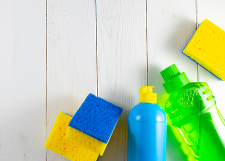 Image view above, flat lay detergent. The concept of Service for cleaning apartments and premises, cleanliness. Cleaning dust in the kitchen, on the floor. Various sanitation items, cleaning tools