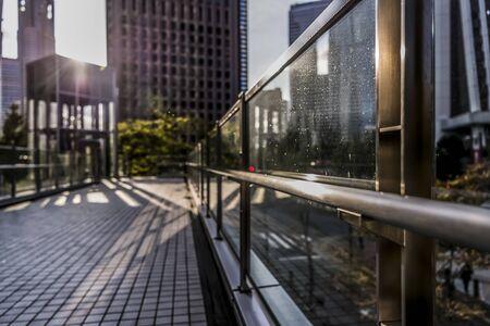 Promenade and railing swarm of high-rise buildings in Nishi-Shinjuku, Shinjuku-ku, Tokyo in the evening