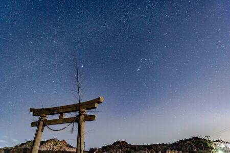Starry sky and torii in the sky seen in Kujukuri-cho, Chiba Prefecture