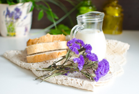Milk, bread and flowers photo