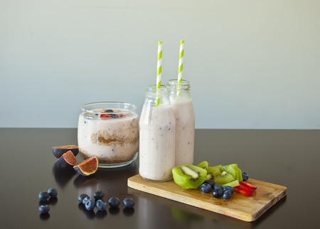 Homemade smoothie with fresh berries and fruits on a table