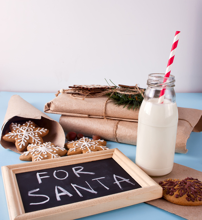 Christmas milk bottle with cookies and gifts Stock Photo