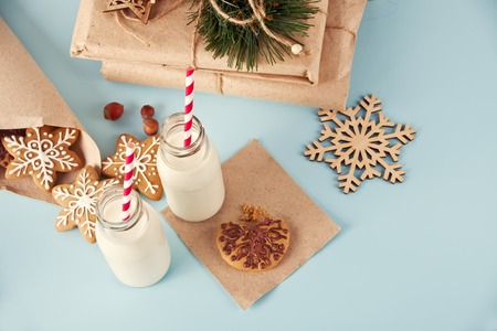 Christmas two milk bottles with cookies Stock Photo