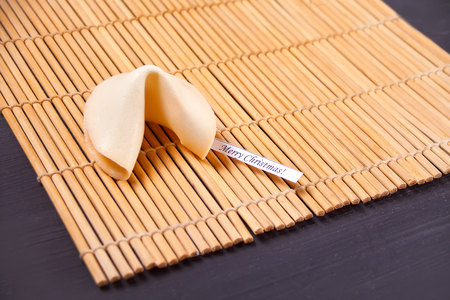 Chinese fortune cookies with prediction for Christmas on the wooden table