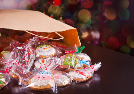Christmas cookie in paper bag a on a wooden background Stock Photo