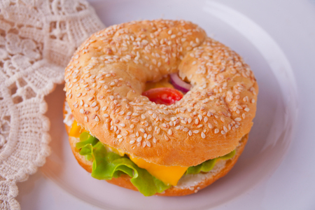Fresh healthy bagel sandwich on a white plate Stock Photo