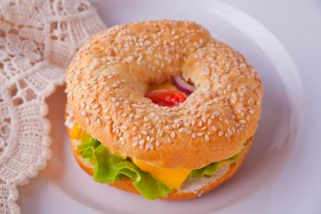 Fresh healthy bagel sandwich on a white plate Stock fotó
