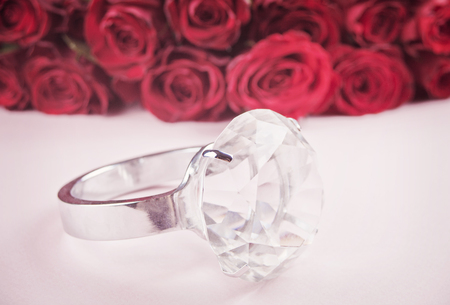 Diamond giant ring and red roses in the background