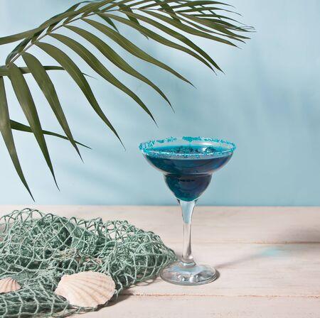 Glass of blue cocktail. Hawaiian cocktai, lagoon cocktail, curacao. Marine theme Stock fotó