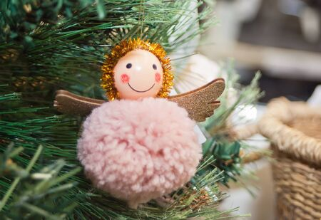 Christmas tree decorated hanging small funny toy angel